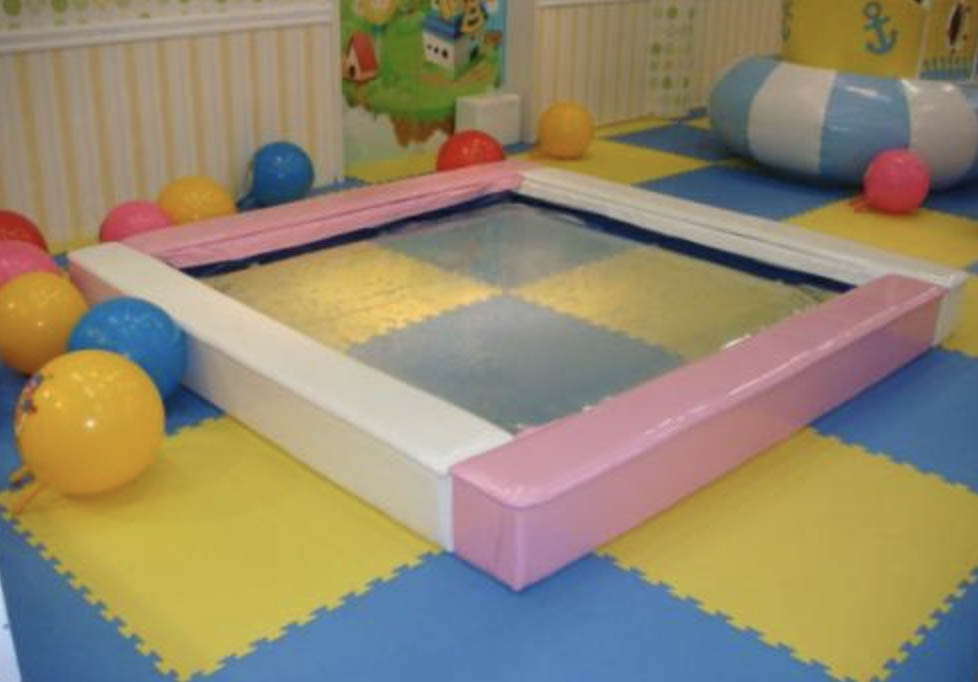 Water bed for indoor playgrounds